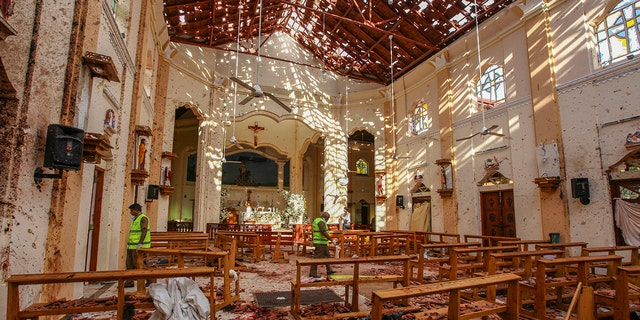 Debris inside St. Sebastian's Church after a blast in Negombo, north of Colombo, Sri Lanka, Sunday. (Associated Press)