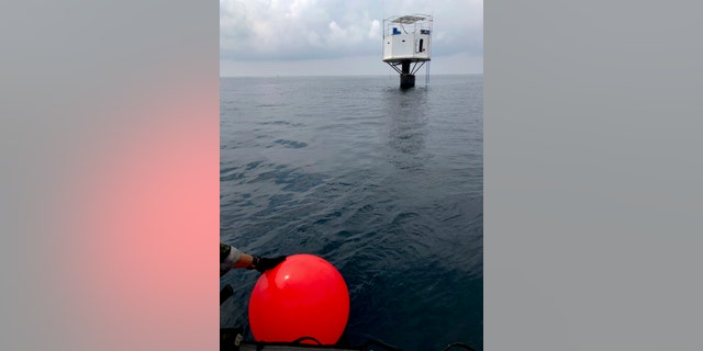 This Saturday, April 13, 2019, photo provided by Royal Thai Navy, shows a floating home lived in by an American man and his Thai partner in the Andaman Sea, off Phuket island, Thailand.