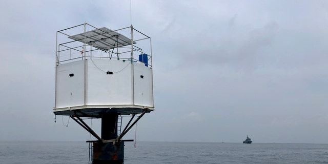 Thai authorities raided a floating home lived in by an American man and his Thai partner off Phuket island on Thursday.