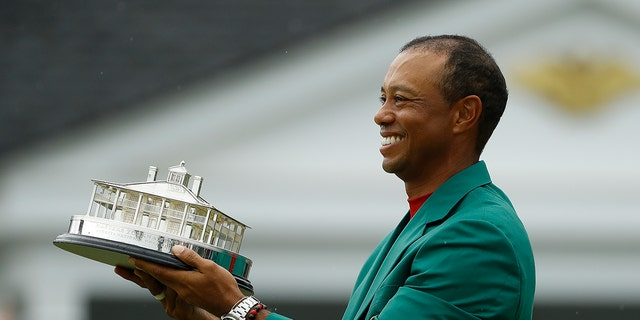 Tiger Woods wears his immature coupler holding a winning prize after a final turn for a Masters golf contest Sunday, Apr 14, 2019, in Augusta, Ga. (AP Photo/Matt Slocum)