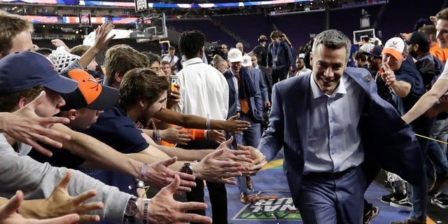 Virginia head coach Tony Bennett celebrates with fans after the championship game against Texas Tech in the Final Four NCAA college basketball tournament, Monday, April 8, 2019, in Minneapolis. Virginia won 85-77 in overtime. (AP Photo/David J. Phillip)
