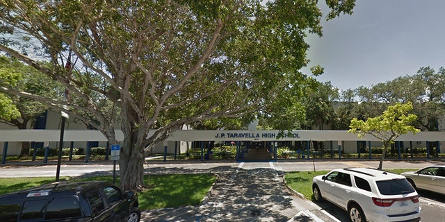 A Florida deputy was been placedon restricted duty after he was seen forcefully restraining a pepper-sprayed J. P. Tavarella High School student.
