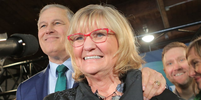 Washington Gov. Jay Inslee (left) and his wife Trudi Inslee as he announces his run for the 2020 Presidency at A & R Solar on March 1, 2019 in Seattle, Washington. (Photo by Karen Ducey/Getty Images)