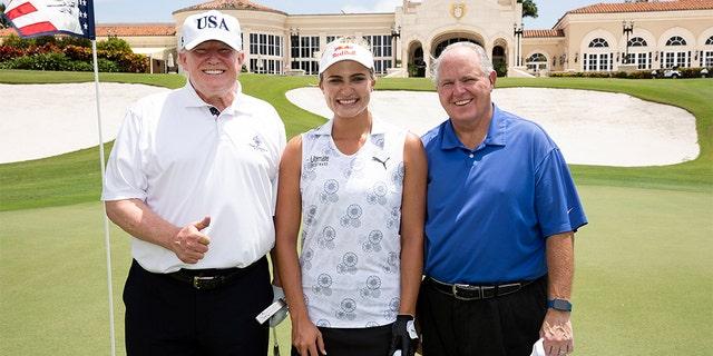 President Trump posing with professional golfer Lexi Thompson and radio host Rush Limbaugh on April 19.