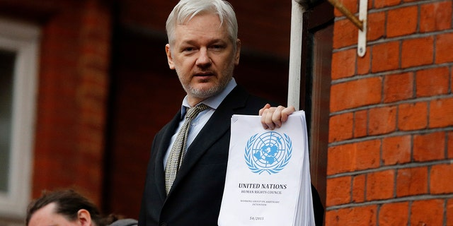 FILE - In this Friday, Feb. 5, 2016 file photo, WikiLeaks founder Julian Assange stands on the balcony of the Ecuadorean Embassy to address waiting supporters and media in London. (AP Photo/Frank Augstein, File)