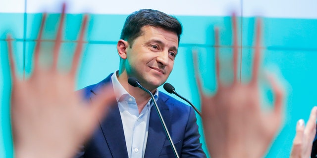 Ukrainian comedian and presidential candidate Volodymyr Zelenski speaks to his supporters at his headquarters after the second round of presidential elections in Kiev, Ukraine, Sunday, April 21, 2019.