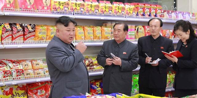 Kim Jong Un visits Taesong Department Store.
