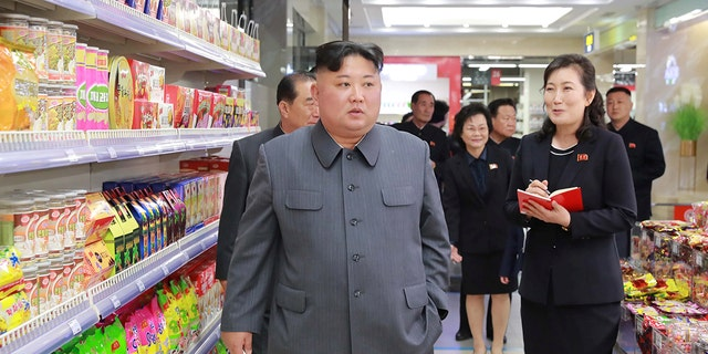 Kim Jong Un visits Taesong Department Store just before its opening, in this photo released on April 8, 2019.