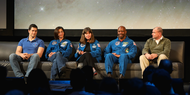Cosmonaut Nikolay Chub and astronauts Nicole Stott, Cady Coleman, Leland Melvin and Tony Antonelli (left to right) lead the Beyond the Cradle 2019 event finale on March 14, 2019.