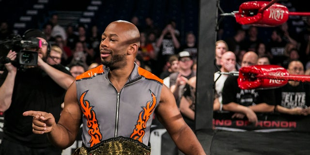 Jay Lethal poses at ringside with the ROH World Championship