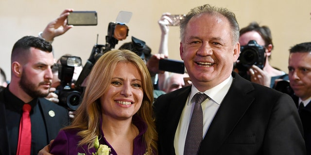 Slovakia's current president Andrej Kiska poses with president-elect Zuzana Caputova at her party's headquarters in Bratislava, Slovakia, March 30, 2019.