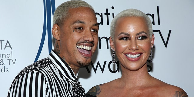 Amber Rose, right, and boyfriend Alexander Edwards attend the National Film and Television Awards Ceremony at Globe Theatre on December 05, 2018 in Los Angeles, Calif. (Photo by Phillip Faraone/Getty Images)