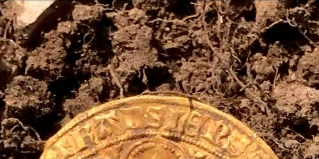 One of the gold coins.The four hunters struck gold in a field in Buckinghamshire and were initially delighted to find 12 ornately decorated silver Edward I and II coins.Over four days they excavated 557 coins - including 12 ultra-rare full gold nobles from the time of the Black Death. (Credit: SWNS)