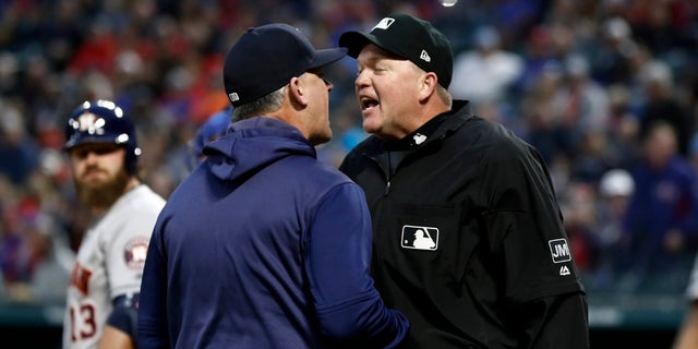 Houston Astros manager AJ Hinch argues with umpire Ron Kulpa, right, during the second inning of the team's baseball game against the Texas Rangers in Arlington, Texas, Wednesday, April 3, 2019.