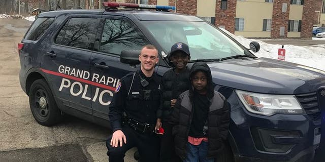 Officer Lynema spotted Thomas Daniels running for his school bus and offered him a ride, with his mom's permission, when the bus didn't stop.