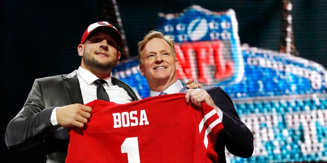 Ohio State defensive end Nick Bosa poses with NFL Commissioner Roger Goodell after the San Francisco 49ers selected Bosa in the first round at the NFL football draft, Thursday, April 25, 2019, in Nashville, Tenn.
