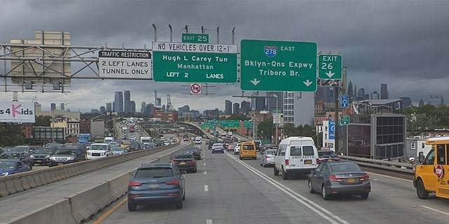 Cars traveling on the Brooklyn Queens Expressway. A cat was rescued hanging off the edge of the highway, thanks to a joint effort between Brooklyn students and the NYPD