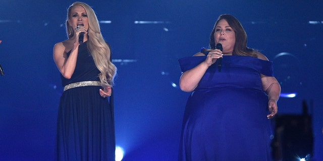 Carrie Underwood, left, and Chrissy Metz perform