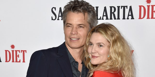 """Actors Timothy Olyphant, left, and Drew Barrymore attend Netflix's """"Santa Clarita Diet"""" season 2 premiere at The Dome at Arclight Hollywood on March 22, 2018 in Hollywood, Calif. (Photo by Axelle/Bauer-Griffin/FilmMagic)"""