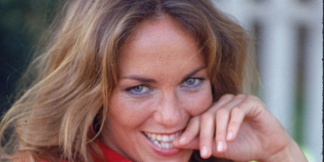 """American actress Catherine Bach on the set of the television show, """"The Dukes of Hazzard,"""" July 1980. — Photo by Fotos International/Getty Images"""