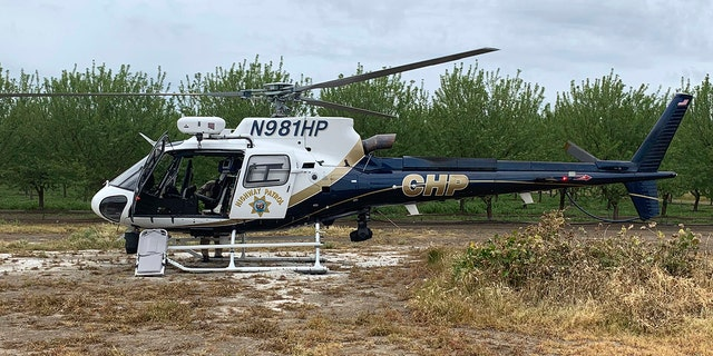 A CHP helicopter is stationed near where two teenage boys were electrocuted while trying to rescue a dog from an irrigation canal at an orchard in Dixon, Calif. (California Highway Patrol/Via AP)