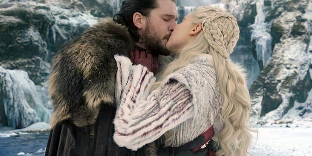 """Game of Thrones"" star Kit Harington said kissing co-star Emilia Clarke was ""odd"" because she's close with his wife, former ""Game of Thrones"" actress Rose Leslie."