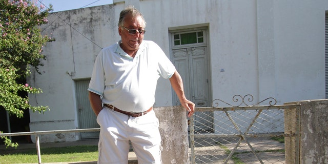 Horacio Sala, father of Argentine soccer player Emiliano Sala, stands outside his home in Progreso, Argentina, Tuesday, Jan. 22, 2019.