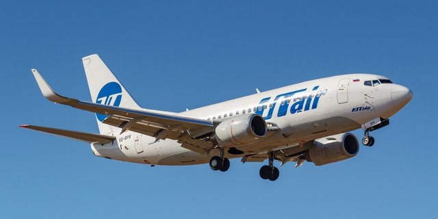 Moscow, Russia - April 03, 2019: Aircraft Boeing 737-524(WL) VQ-BPR of UTair Aviation going to landing against blue sky at Vnukovo international airport in Moscow at sunny day