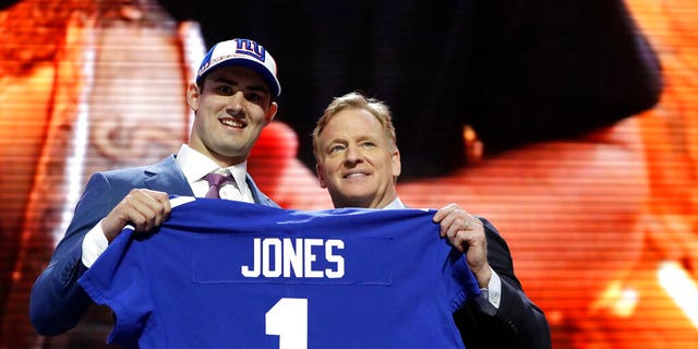 Duke quarterback Daniel Jones poses with NFL Commissioner Roger Goodell after the New York Giants selected Jones in the first round at the NFL football draft, Thursday, April 25, 2019, in Nashville, Tenn.