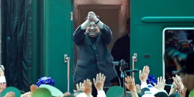 In this March 2, 2019, file photo, North Korean leader Kim Jong Un waves from his train as he arrives at the railway station in Dong Dang, Vietnam.