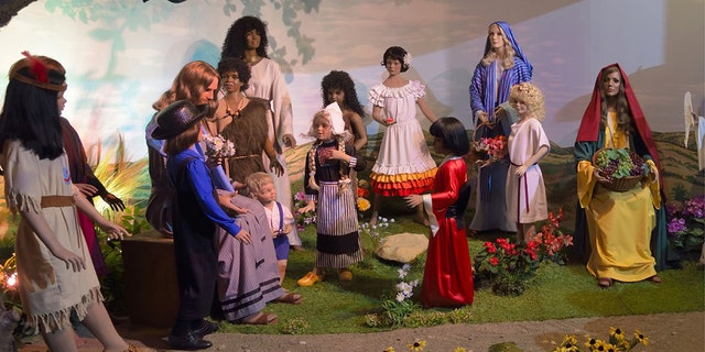 Visitors interact with the scene of Jesus and the little children at the BibleWalk wax museum in Mansfield, Ohio.