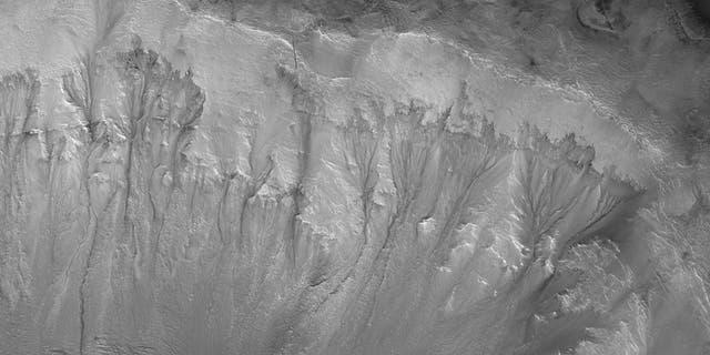 Recurrent Slope Linae on the Palikir Crater walls on Mars. (Credit: NASA/JPL/University of Arizona)