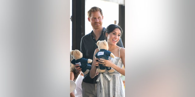 Britain's Prince Harry and his wife Meghan, the Duchess of Sussex attend a meet-the-people walk at Kingfisher Bay Resort on Fraser Island on October 22, 2018.