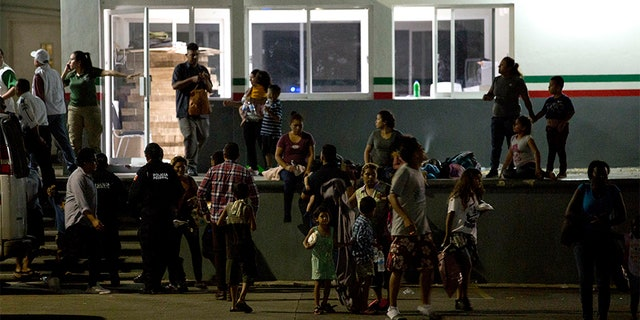 Migrants wait for their transfer from an immigration detention center in Tapachula, Chiapas state, Mexico, on Thursday.