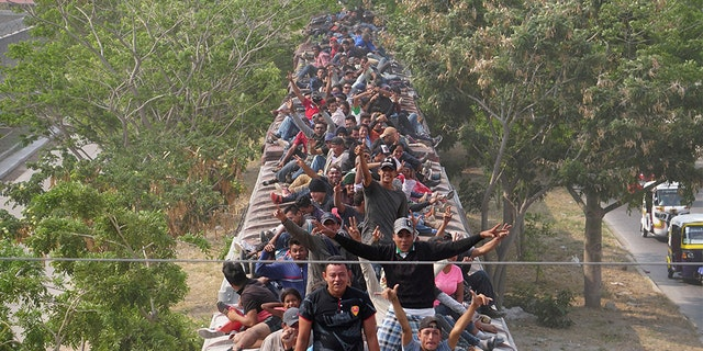 "Central American migrants, moving in a caravan through Juchitan, Oaxaca are pictured atop a train known as ""The Beast"" while continuing their journey toward the United States, in Mexico April 26, 2019."