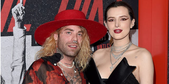 Mod Sun and Bella Thorne arrive at the premiere of Netflix's 'The Dirt' at ArcLight Hollywood on March 18, 2019 in Hollywood. They split just weeks later after dating for more than a year.