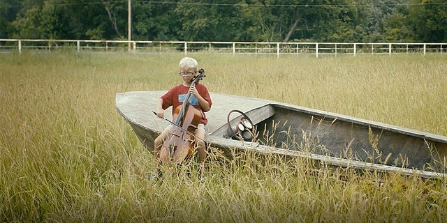 """""""Nebraska is kind of like that odd kid – slightly peculiar, but interesting when you spent time with him. Some people won't spent the time, but maybe you will,"""" an unseen narrator says in one video, which features a little boy playing a cello alone in a cornfield."""