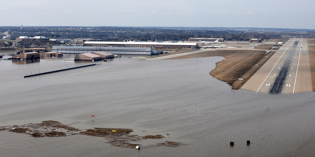 FILE: An aerial view of Offutt Air Force Base and surrounding areas in Nebraska affected by flood waters.