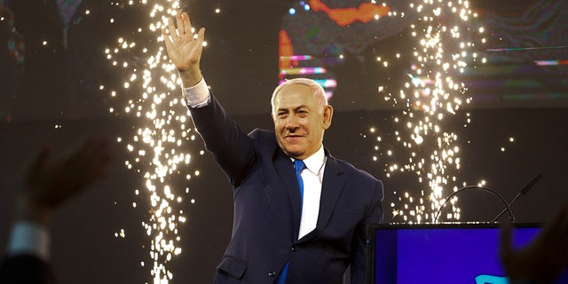 Israel's Prime Minister Benjamin Netanyahu waving to his supporters after polls for Israel's general elections closed in Tel Aviv, Israel, on Wednesday. (AP Photo/Ariel Schalit)