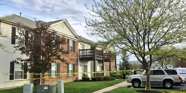 Police tape cordons off the scene where multiple people were found dead Sunday night, at the Lakefront at West Chester apartment complex in West Chester Township, Ohio.