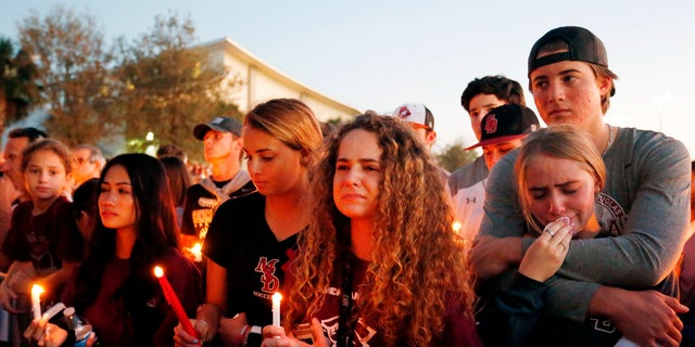 Mourners react during a candlelight vigil for the victims of the Marjory Stoneman Douglas High School shooting in Parkland, Florida on February 15, 2018. (RHONA WISE/AFP/Getty Images)
