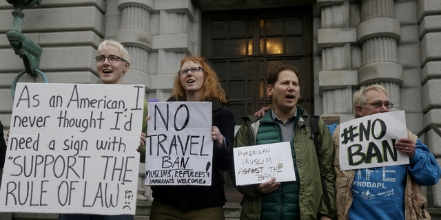 Protesters outside the 9th Circuit.  (AP)