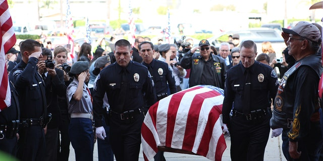 Navy petty officer Raul Guerra's burial was held in Whittier, Calif., Thursday, 52 years after he was killed in action in Vietnam.