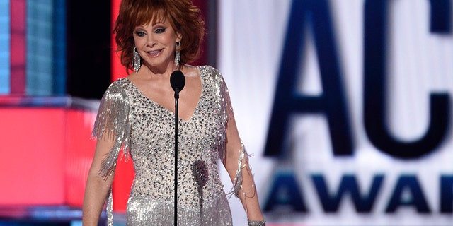 Host Reba McEntire speaks at the 54th annual Academy of Country Music Awards at the MGM Grand Garden Arena on Sunday, April 7, 2019, in Las Vegas.