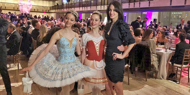 "Choreographer Melanie Hamrick poses with dancers at the gala of Youth America Grand Prix, the world's largest ballet scholarship competition, on Thursday, April 18, after the U.S. premiere of her new ballet, ""Porte Rouge"" (Red Door), based on classic Rolling Stones tunes arranged by her partner, Mick Jagger. The Stones frontman, recovering from medical treatment, watched from backstage and addressed the audience briefly via microphone before the show. (AP Photo/Jocelyn Noveck)"