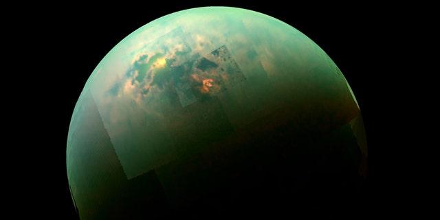 This near-infrared, color view from Cassini shows the sun glinting off of Titan's north polar seas. (Credit: NASA/JPL-Caltech/Univ. Arizona/Univ. Idaho)