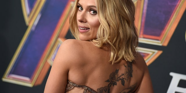 """Scarlett Johansson's tattoo is on display when she walks the carpet at the premiere of """"Avengers: Endgame"""" at the Los Angeles Convention Center on Monday, April 22, 2019."""