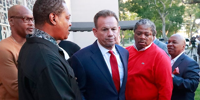 Broward County Sheriff Scott Israel, center, leaves a news conference surrounded by supporters after Florida Gov. Ron DeSantis suspended him in January.