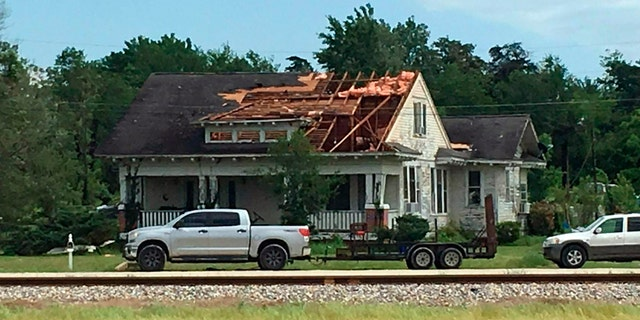 A roof is torn off a home following a suspected tornado, Saturday, April 13, 2019 in Franklin, Texas.