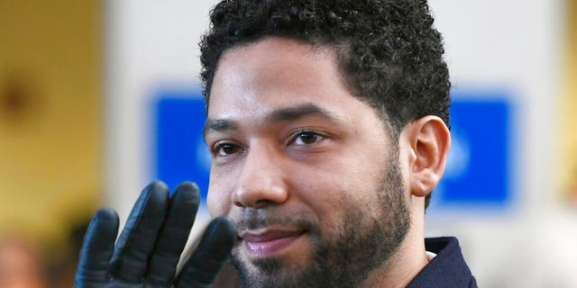 FILE - In this March 26, 2019, file photo, actor Jussie Smollett smiles and waves to supporters before leaving Cook County Court after his charges were dropped in Chicago. (AP Photo/Paul Beaty, File)